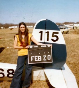 Mom as a youngin next to a plane
