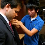 Orlando Sentinel videographer Sean Pitts mic'ing up Senator Marco Rubio.