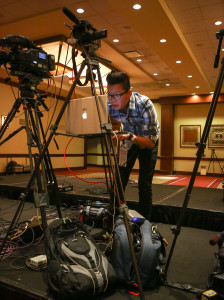 Sentinel staffer Sean Pitts sets up for a live stream before UCF coach George O'Leary talks with the media during a press conference before the Tostitos Fiesta Bowl media day at the JW Marriott Scottsdale Camelback Inn Resort & Spa in Scottsdale, AZ. on Tuesday, December 31, 2013. (Joshua C. CrueyOrlando Sentinel)